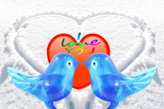 Bluebird lovebird glass art with heart snow background Royalty Free Stock Photo