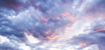 Bluefire Clouds. Sky ablaze with bold hues of pink and blue, photographed at sunset Stock Photography