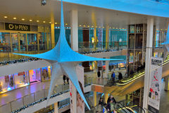 Blueish star and People walking in a shopping mall Stock Images