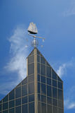Bluenose Weather Vane. A weather vane,  with a compass, in the shape of the schooner 'The Bluenose' on top of the World Trade Building in Halifax, Nova Scotia Stock Photo