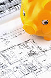 Blueprint. Of a house with a piggy bank, standing for saving money Stock Photo