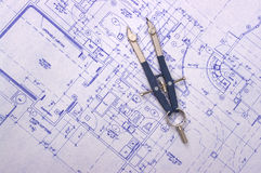Blueprint. With compass on top of it Royalty Free Stock Image