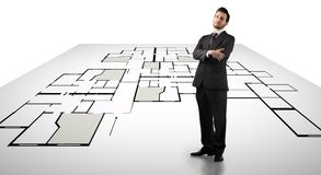 Blueprint. A businessman standing on a digital blueprint stock image