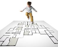 Blueprint. A kid jumping an playing on a digital blueprint royalty free stock photo