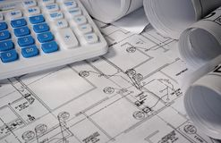 Blueprint building plan with calculator Stock Images
