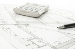 Blueprint with calculator and pen Stock Photo