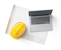 Blueprint, helmet and laptop on isolated background Royalty Free Stock Images