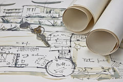 The blueprint of a house. With two paper rolls and the keys for the new house Royalty Free Stock Photo