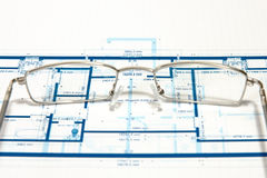 Blueprint for a house. And eyeglasses Stock Photo