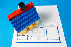 Blueprint for a house and a model house. Built from plastic blocks Royalty Free Stock Photography