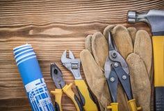 Blueprint il adjusta dei colpi di forbici della latta delle pinze del martello da carpentiere dei guanti protettivi Fotografia Stock
