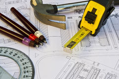 Blueprint with objects. Blueprint with pen, hammer and tape measure with great colors Stock Photo