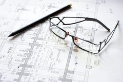 Blueprint pencil glasses. Black pencil, glasses lying on a blueprint Royalty Free Stock Photo