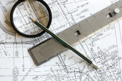 Blueprint with pencil, loupe and steel scale ruler Royalty Free Stock Photography