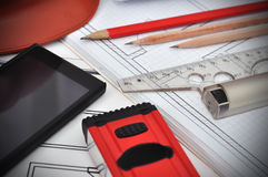 Blueprint, phone and tools Stock Images