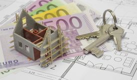 Architectural plan with euro banknotes and house keys Royalty Free Stock Photos