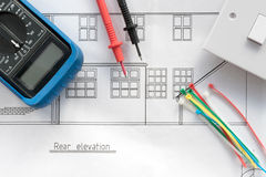 Blueprint plans and electrical items. Blueprint plans with some electrical items Royalty Free Stock Photo