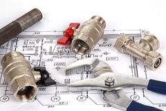 Blueprint and plumbing supplies royalty free stock photos