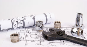 Blueprint and plumbing supplies Royalty Free Stock Images