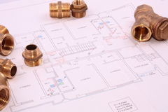 Blueprint and plumbingl items Royalty Free Stock Images