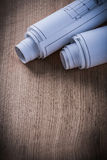 Blueprint rolls on wooden board architecture and building concep Royalty Free Stock Photo