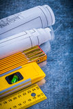 Blueprint rolls yellow ruler construction level Stock Photos