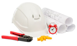 Blueprint rols and helmet with tools Stock Photography