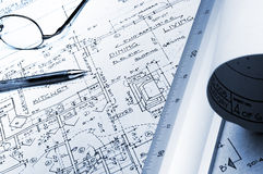 Blueprint with ruler and glasses Stock Images