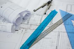 Blueprint with ruler, pencil and thumbscrew compasses Stock Photos