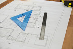 Blueprint with ruler on table Stock Images