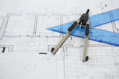 Blueprint with ruler and thumbscrew compasses Stock Images