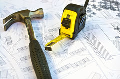 Blueprint with some materials. Blueprint with a tape measure and a hammer with great colors Stock Photos