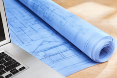 Blueprint on wooden desk Royalty Free Stock Image