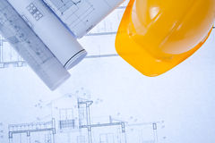 Blueprint and yellow hardhat. Construction Blue print and yellow hard hat Stock Image