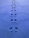 Blueprints?. Footprints in the blue sand Royalty Free Stock Images