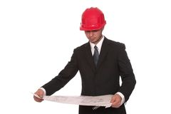 Blueprints. Architect looking over a buildings blueprints Royalty Free Stock Photography