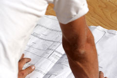 Blueprints. A designer looks over his plans for a new home Royalty Free Stock Photo