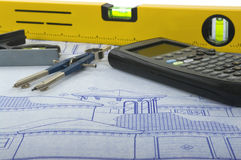Blueprints. Tools like calculator, compass, level and more Stock Photos