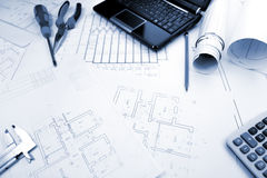 Blueprints background with computer and tools Stock Photo