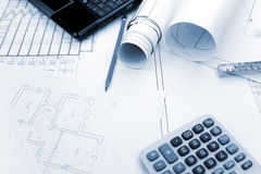 Blueprints background with computer and tools Royalty Free Stock Image