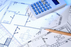 Blueprints and calculator Stock Image