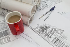 Blueprints with cup of coffee royalty free stock photography