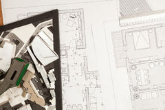 Blueprints and 3D plans on architect table Royalty Free Stock Photo