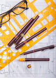 Blueprints and drafting tools. Royalty Free Stock Image