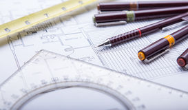 Blueprints and drafting tools. Royalty Free Stock Images