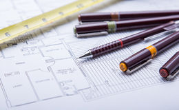 Blueprints and drafting tools. Stock Photos