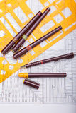 Blueprints and drafting tools. royalty free stock photography