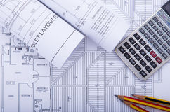 Blueprints and drafting tools. Stock Image
