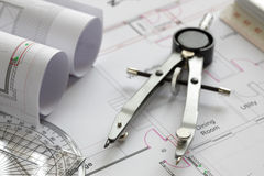 Drawing compass on house plan Royalty Free Stock Photography
