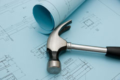 Blueprints and a hammer Royalty Free Stock Photography